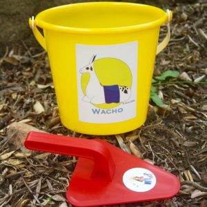 Yellow bucket and red trowel